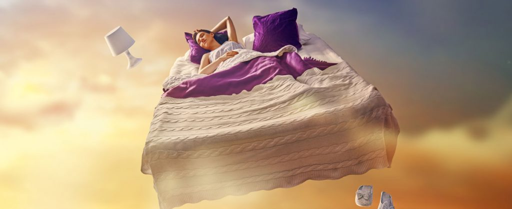 Woman sleeping in ethereal bed