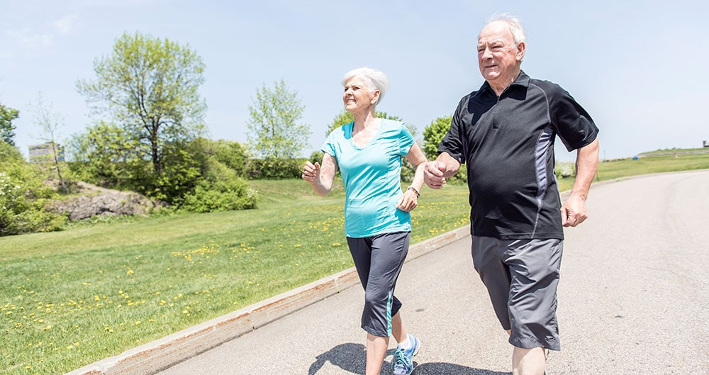 Older couple out for a brisk walk